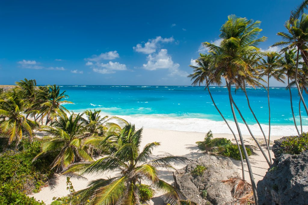 Bottom Bay is one of the most beautiful beaches on the Caribbean island of Barbados. It is a tropical paradise with palms hanging over turquoise sea. Best hidden gem beaches barbados