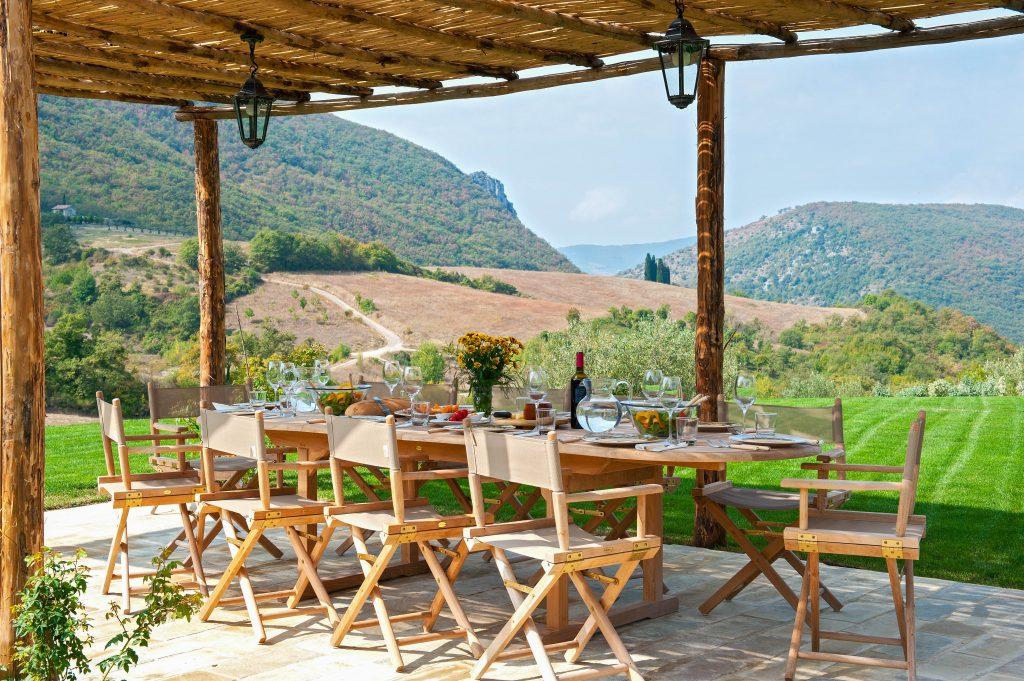 Alfresco dining area at villa Dulfa, Umbria. Easter in Italy